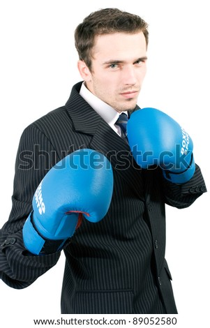 Handsome male model, young man, attractive businessman in suit and gloves boxing and relaxing in office, made in studio isolated on white background - stock photo