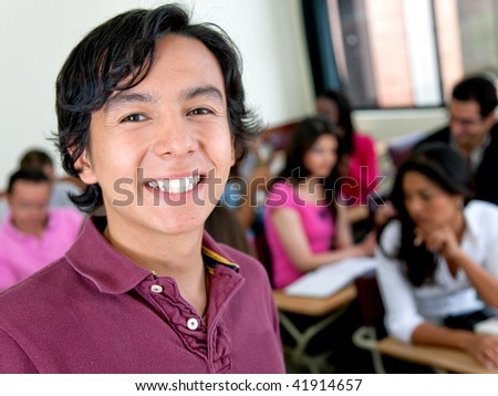 Handsome male student at the university smiling - stock photo