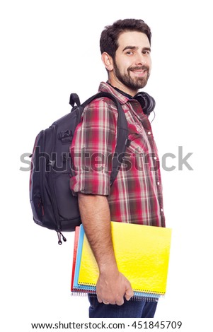 Handsome male student standing on white background