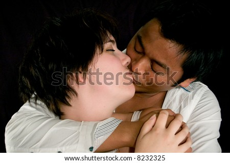 handsome man and beautiful woman kissing eachother - stock photo