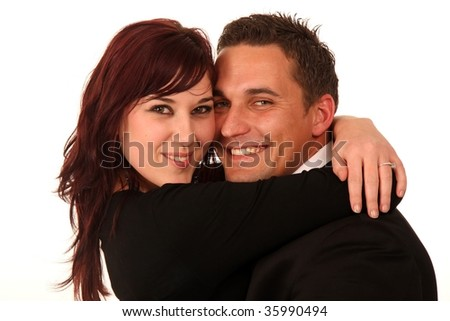Handsome man and pretty woman hugging