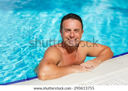 Handsome man at beach pool, sexy male model fit man posing in swimming pool, male model in swimwear at summer vacation, attractive man model outdoor portrait, Man sunbathing on the beach, series - stock photo
