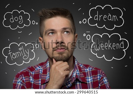 Handsome man at gaze. Man in maroon plaid shirt thinking about several things: to walk with a dog, to stay with family, how to spend weekend etc. - stock photo
