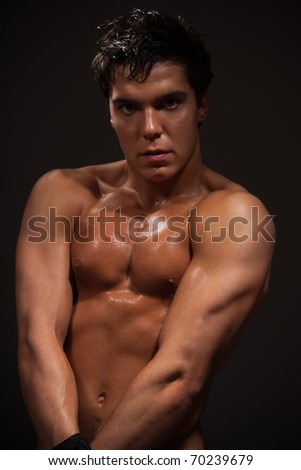 Handsome man  body-buildier with big beautiful mussels - stock photo