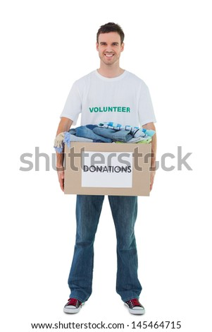 Handsome man carrying donation box on white background - stock photo