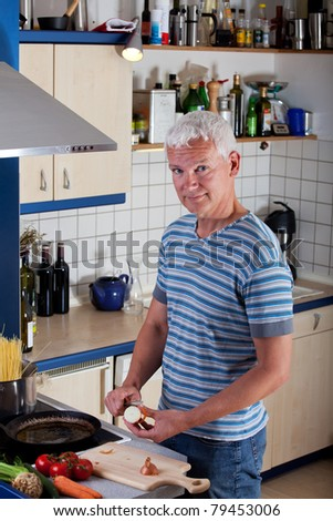 handsome man cooking pasta in the kitchen