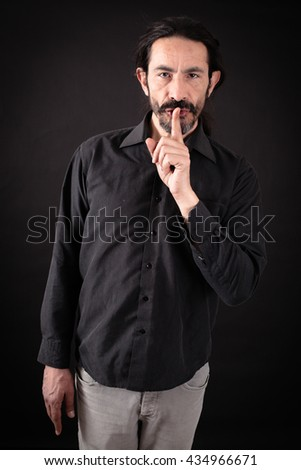 Handsome man doing different expressions in different sets of clothes: - stock photo