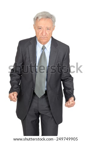 Handsome man doing different expressions in different sets of clothes: angry - stock photo