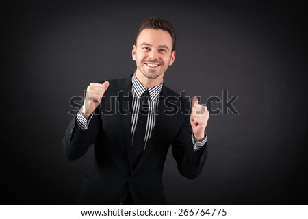 handsome man doing different expressions in different sets of clothes: ` arms raised - stock photo