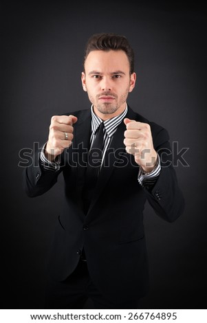 handsome man doing different expressions in different sets of clothes: ` boxe - stock photo