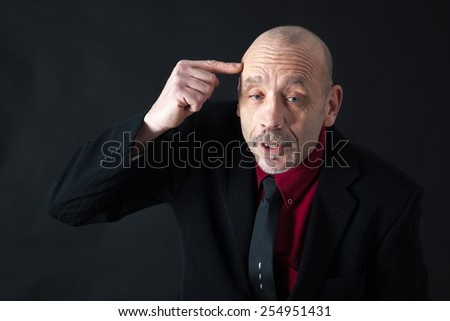 Handsome man doing different expressions in different sets of clothes: drunk - stock photo