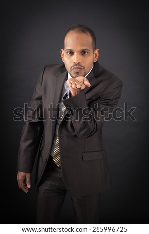 Handsome man doing different expressions in different sets of clothes: kiss - stock photo