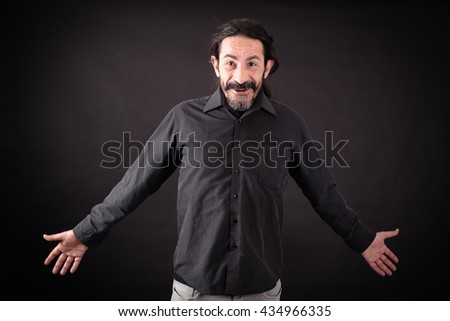 Handsome man doing different expressions in different sets of clothes: surprise - stock photo