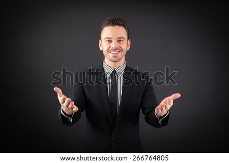 handsome man doing different expressions in different sets of clothes: `welcome - stock photo