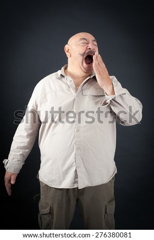 Handsome man doing different expressions in different sets of clothes: yawn - stock photo