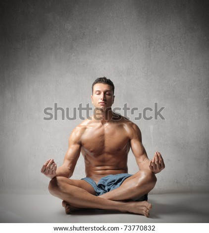 Handsome man doing yoga exercises - stock photo