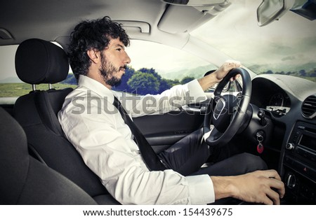 handsome man driving a car