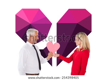 Handsome man getting a heart card form wife against broken heart - stock photo
