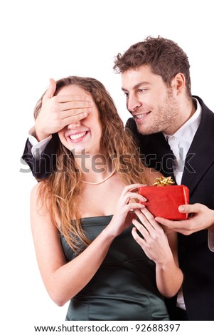 Handsome Man Giving a Gift on Valentine's Day - stock photo