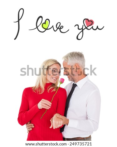 Handsome man giving his wife a pink rose against i love you - stock photo