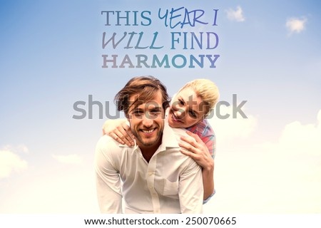 Handsome man giving piggy back to his girlfriend against this year i will find harmony - stock photo