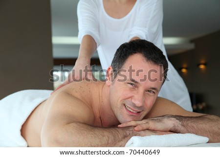 Handsome man having a massage - stock photo
