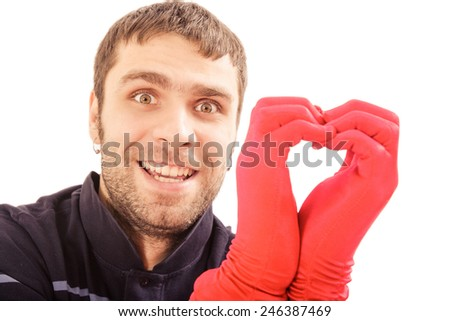 handsome man hold heart made from hands in red gloves in Valentine day - stock photo