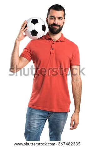 Handsome man holding a soccer ball - stock photo