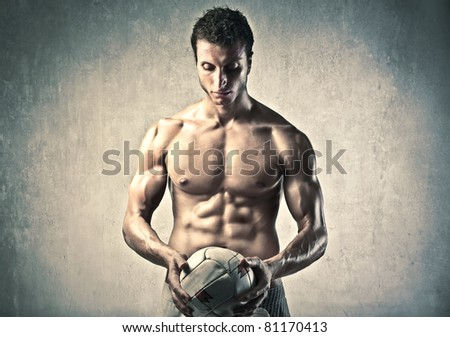 Handsome man holding a volleyball - stock photo