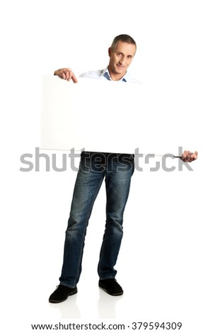Handsome man holding an empty banner - stock photo