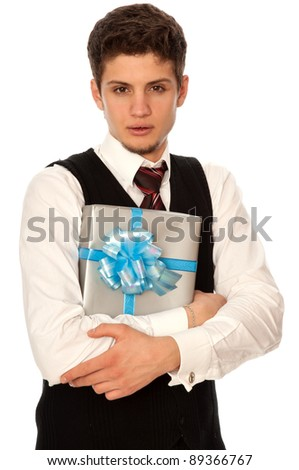 handsome man holding in the hands the gray box with blue ribbon as a gift for his girlfriend - stock photo