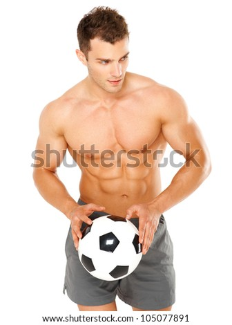 Handsome man holding soccer ball on white background - stock photo
