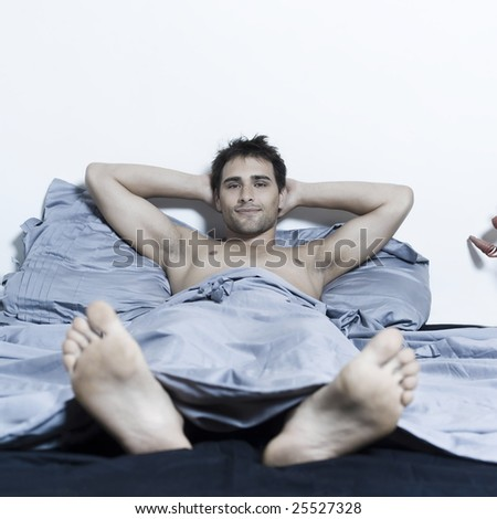 handsome man in a bed on isloated background - stock photo