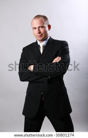 Handsome man in a dark suit - stock photo