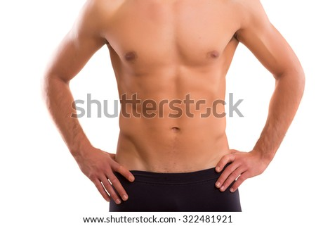 Handsome man in a great shape, isolated over a copy space background
