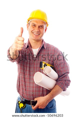 handsome man in a helmet with a builder tool shows a gesture OK - stock photo