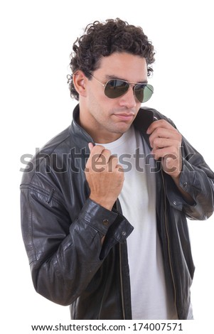 handsome man in a leather jacket with sunglasses