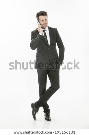 handsome man in a suit using a phone on isolated background - stock photo