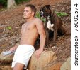 Handsome Man in Boxer Shorts with Boxer Dog - stock photo