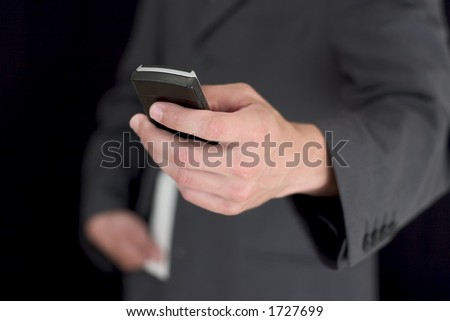 Handsome man in business suit calling on his mobile.