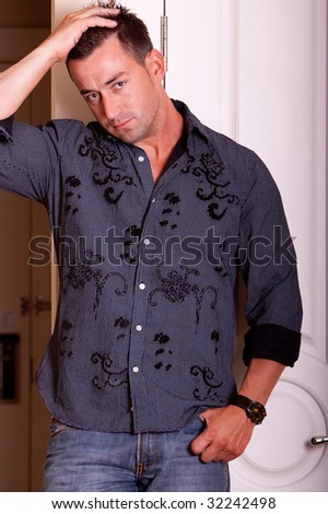 Handsome man in dark shirt and blue jeans