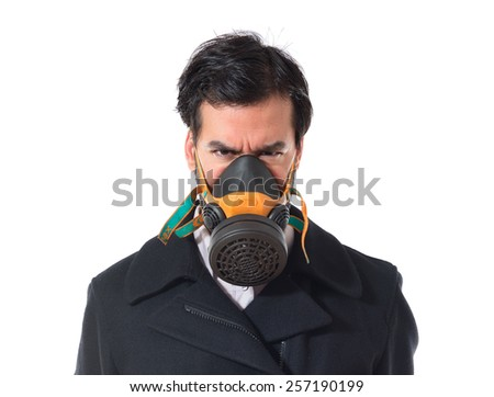 Handsome man in gas mask - stock photo