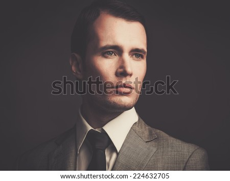Handsome man in grey suit - stock photo