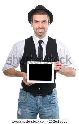 Handsome man in hat showing digital tablet pc. Isolated on white. - stock photo