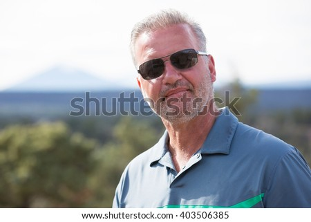 Handsome man in his 50s - stock photo