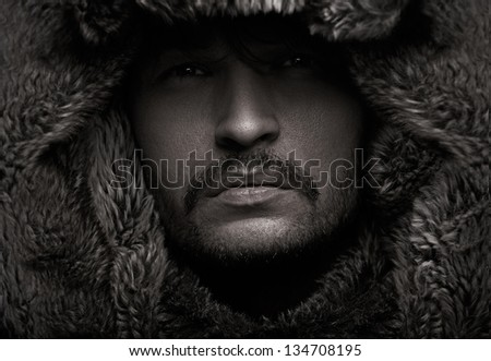 Handsome man in hood - stock photo