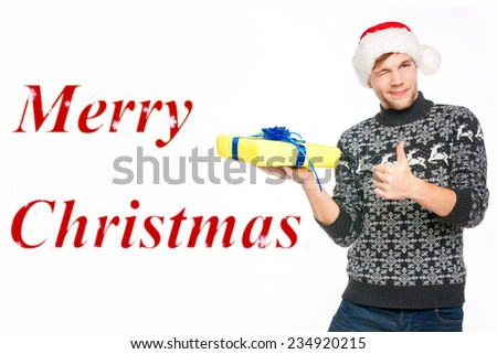 Handsome man in Santa's hat and Norwegian sweater smiling. Isolated on white background  - stock photo