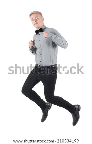 Handsome man in shirt and bow-tie jumping - stock photo