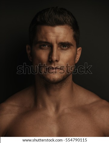 Handsome man in studio close up portrait