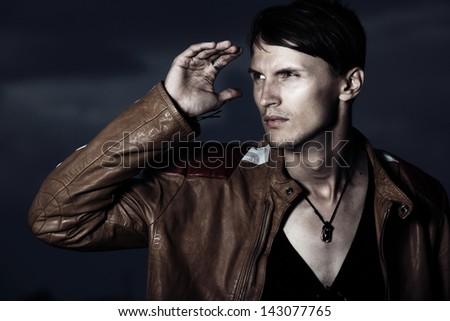 Handsome man in stylish leather jacket - stock photo